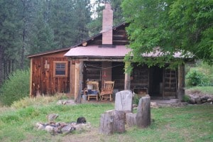 old cabin in wooded area